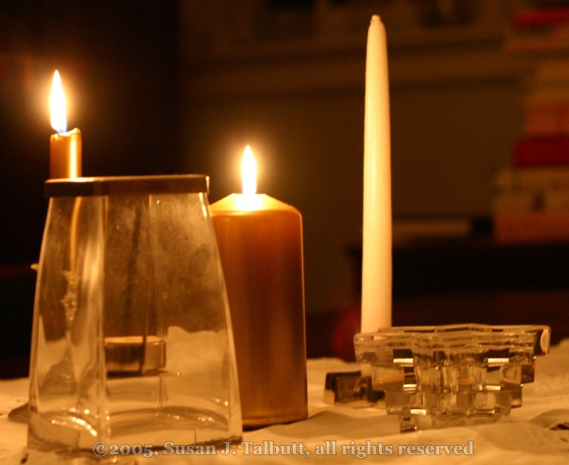 [Variety of candles lit for Advent; copyright 2005, Susan J. Talbutt, all rights reserved]
