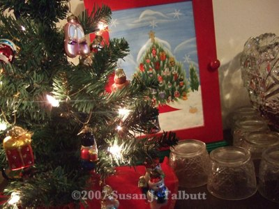 [Miniature Christmas tree my friends use as an advent calendar, hanging one decoration a day.]