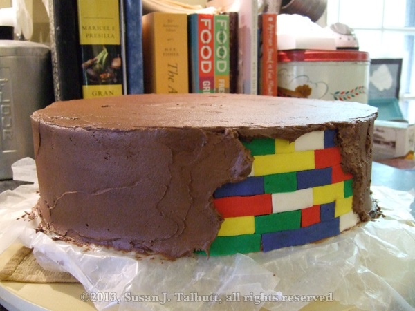[Lego cake: chocolate icing spread over fondant 'bricks', copyright 2013, Susan J. Talbutt, all rights reserved]