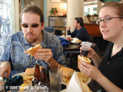 [My husband and I eat po-boys for lunch at the Market Cafe, December 2003]