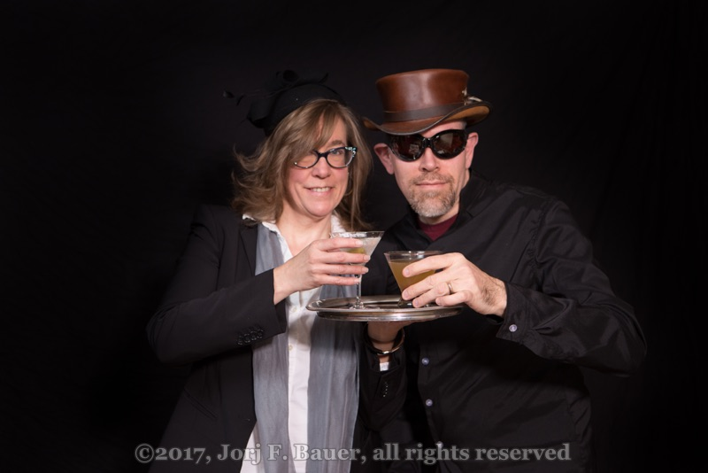 [An older couple raising a martini cocktail and a sidecar cocktail to you; copyright 2017 Jorj F. Bauer, all rights reserved]